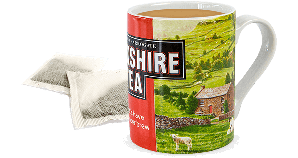 Yorkshire Tea in a mug with a bag on the side